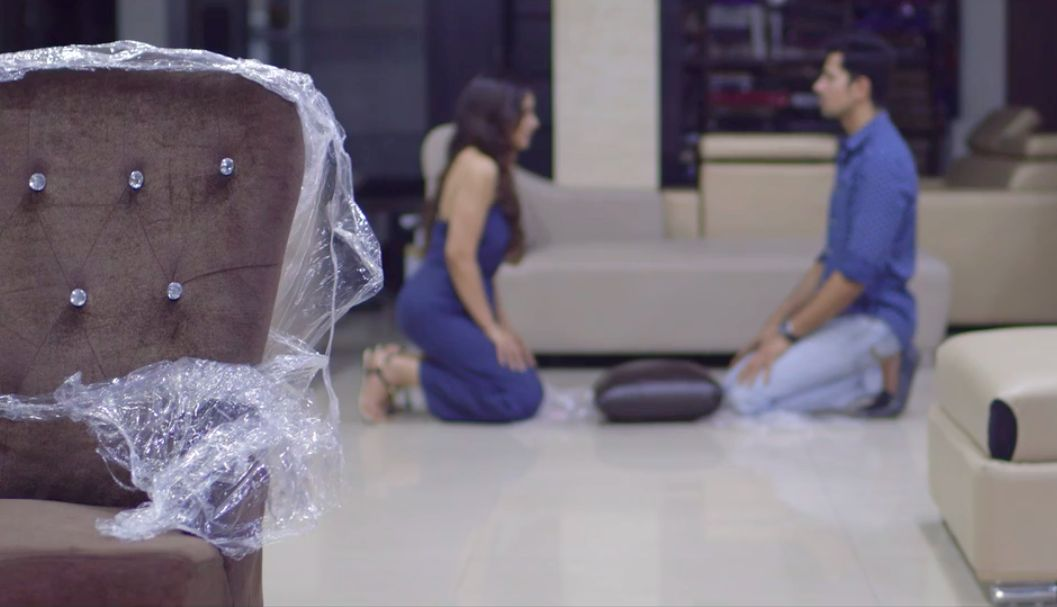Mikesh and Tanya sitting and the 'Torn Chair' in Permanent Roommates