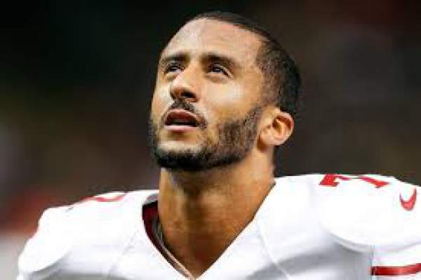49ers' Colin Kaepernick Protests Racial Injustice By Sitting During National Anthem