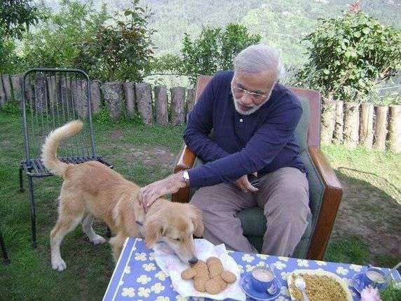 Narendra Modi offering biscuits to his dog